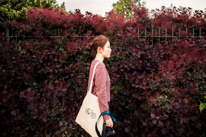 A girl with tote bag walking
