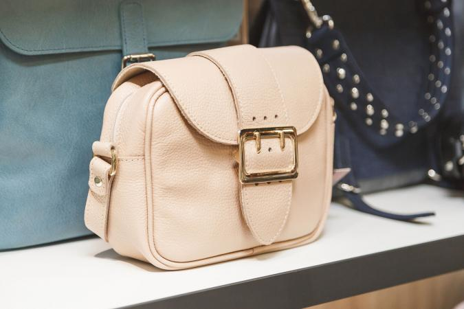 Tan handbag on shelf in store