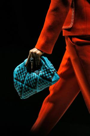 Model holding Bottega Veneta handbag