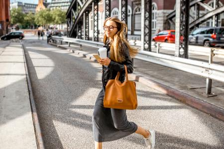 Woman running errands with leather tote