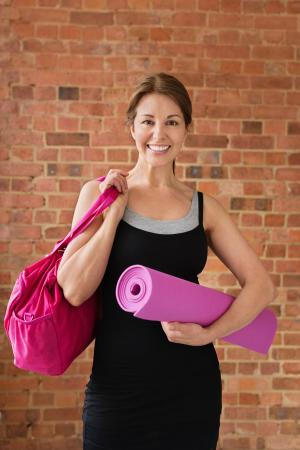 Woman holding pink gym tote
