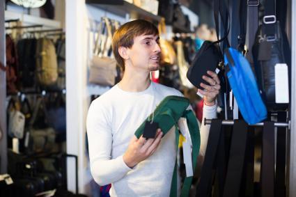 Man shopping for vertical purse