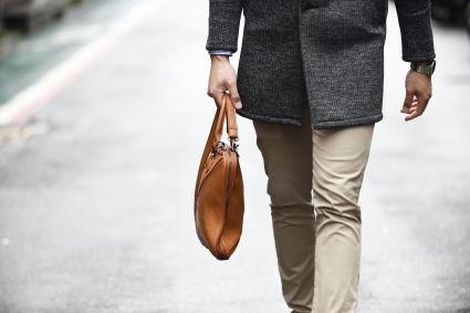 Man carrying a purse or murse