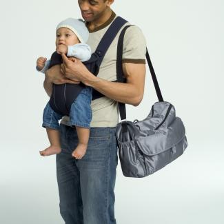 Man with baby and diaper shoulder bag