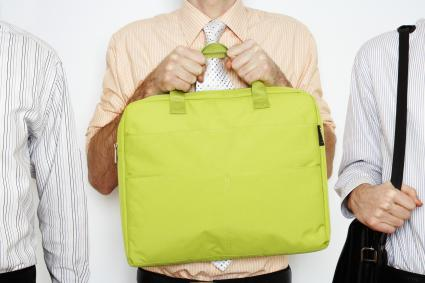 Man holding yellow tote computer bag
