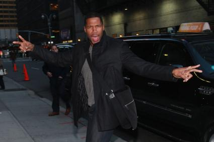 Michael Strahan with crossbody messenger bag