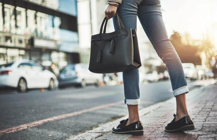 businesswoman walking with her handbag