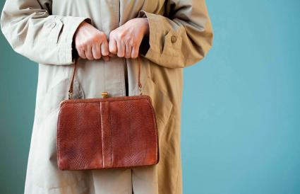 Senior woman holding pocketbook