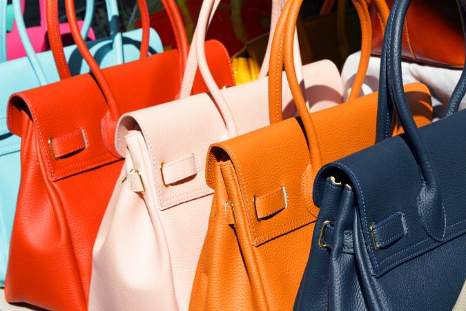 Colorful leather handbags in different colors