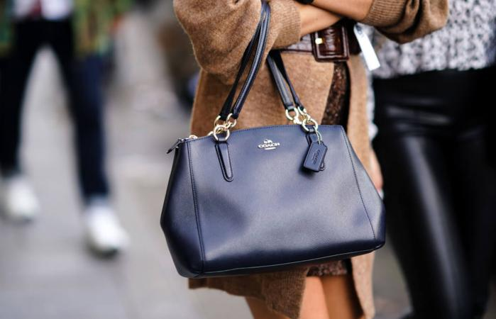 Woman with Coach bag