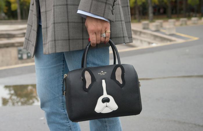 Businesswoman holding a handbag