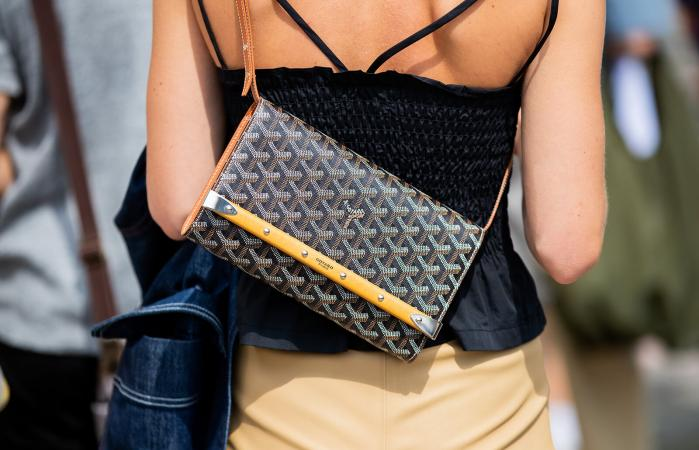 woman wearing Goyard bag