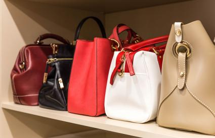 handbags in woman closet