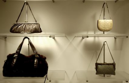 purses in floating acrylic shelves