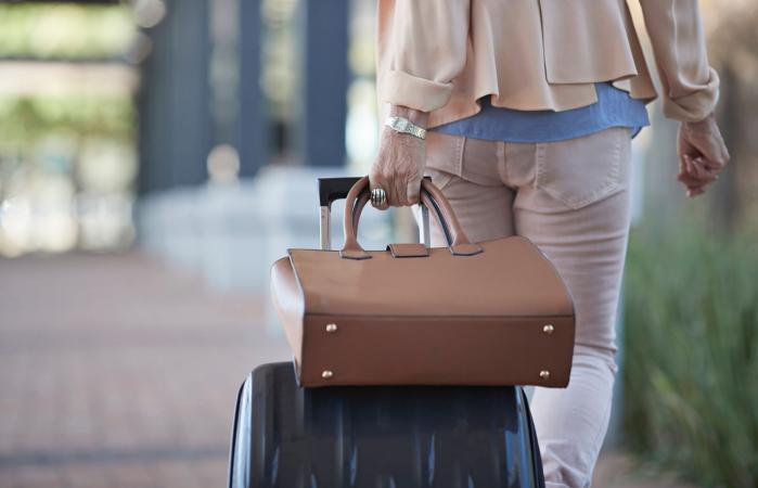 Woman traveling with purse