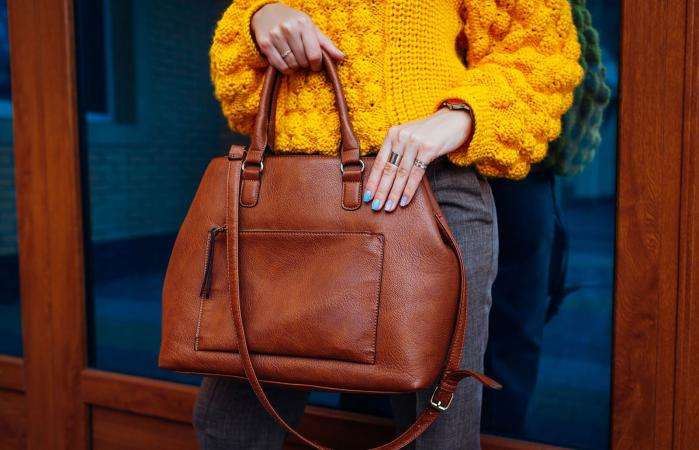 Woman holding a stylish, everyday bag
