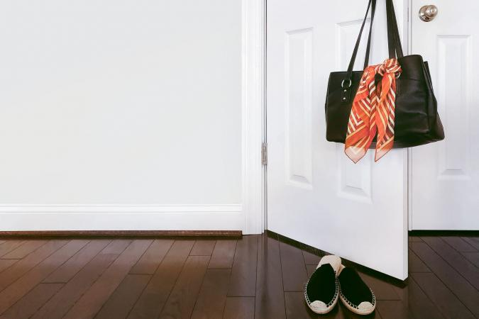 Purse With Scarf Hangs on Doorknob