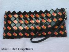 black clutch with grapefruits