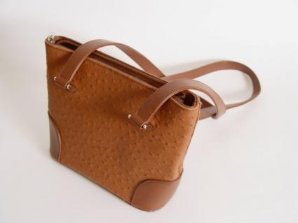 Image of a burnt sienna leather shoulder bag