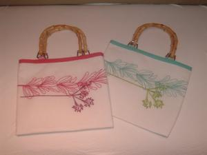Embroidered Kathi bags with bamboo handles