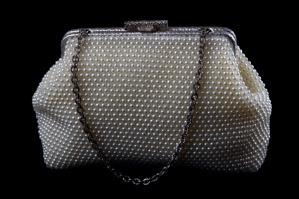 Image of a dotted clutch purse