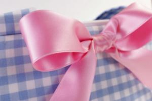 Placemat purse with a pink ribbon