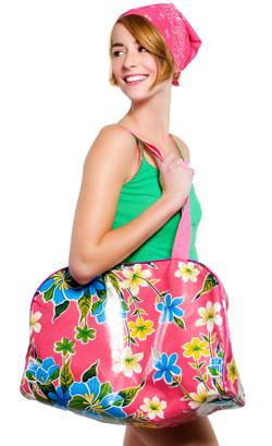 Young woman carrying a floral print tote bag