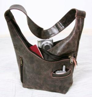 Image of a small, distressed gray messenger bag