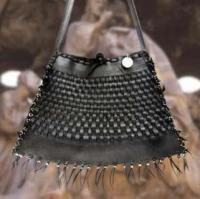 black rubber purse with fringe