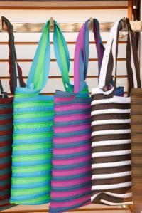 Four handbags stored side by side