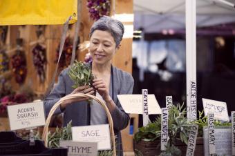 Woman at market buying herbs