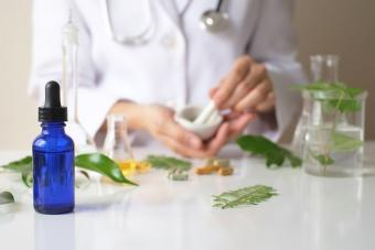 person mixing herbal remedy