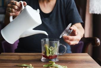 woman steeping healthy herbal detox tea