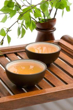 Green tea in two brown cups