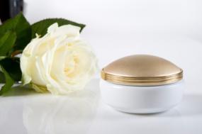Jar of salve and a rose