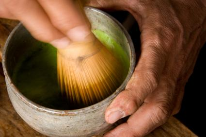 Macha green tea being prepared