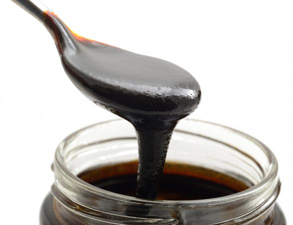 Closeup of blackstrap molasses with background