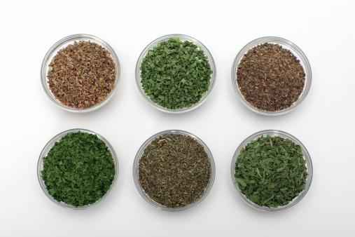 Dried herbs in bowls
