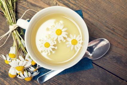 Chamomile Tea With Daisies In Cup