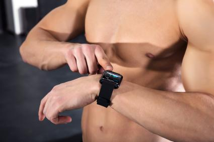 Athlete Man Checking His Heart Rate Using Smart Watch
