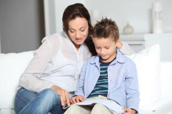 Mother reading with son