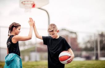 high-five after basketball game