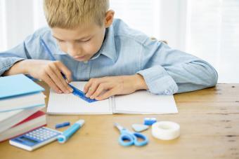 Boy using a ruler