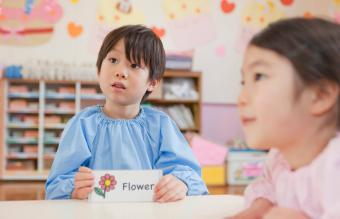 Kindergarten Boy Holding Picture Card