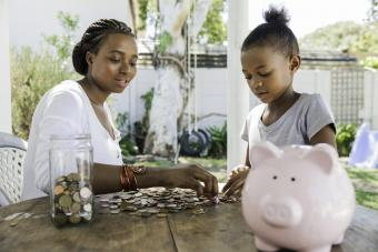 Mom counting coins with her daughter