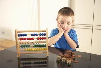 Boy looking at money