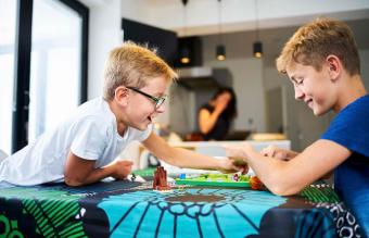 Two brothers playing a board game