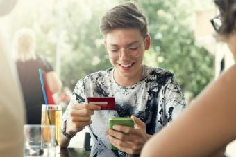 Teenage boy using his credit card