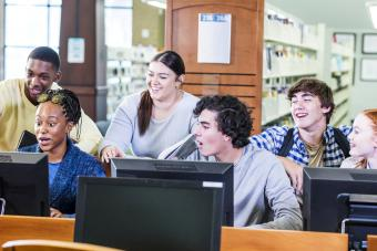 Students in library on computers together