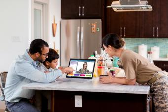 Parents help son with distance learning